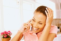 Woman laughing on cell phone