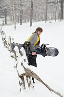 Boy carrying snowboard