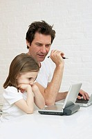 Father and daughter with digital gadgets