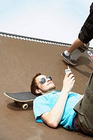 Skateboarder checks his messages