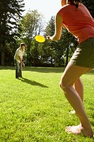 Couple playing frisbee
