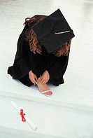 A New Graduate Adjusts Her Shoe