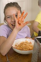 Girl playing with her spaghetti