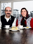 Mature Turkish Couple Sitting at Table