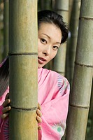 Woman in Kimono in Bamboo Forest