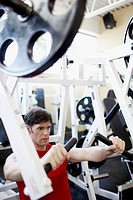 Man Exercising at Gym