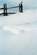 Wooden Fence and Deep Snow