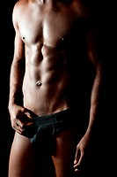 Naked torso of young muscular man
