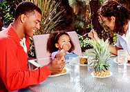 Family Eating Pineapple
