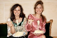 Women Eating Spaghetti