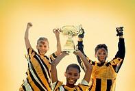 Soccer Teammates Holding Trophy