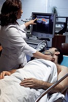 Doppler ultrasound. A patient undergoing a doppler ultrasound investigation of the common carotid artery in the neck. Doppler ultrasound gives a view ...