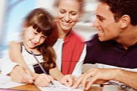 Child Drawing with Her Parents