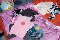 Teenager´s Bed Covered with Clothes