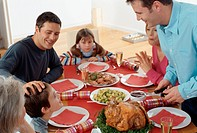 Family Sitting at Table for Christmas Dinner