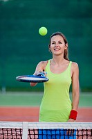 pretty, young female tennis player on the tennis court