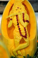 Indian wedding ceremony human figure cut in pumpkin for decoration , Bombay Mumbai, Maharashtra , India