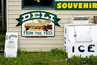 Signs on deli and grocery store, Moose Pass, Kenai Peninsula, Alaska, USA, late August