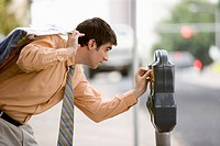 Businessman checking parking meter
