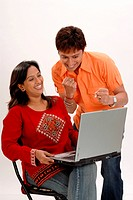 South Asian Indian husband and wife working on laptop ; Bombay Mumbai ; Maharashtra; India MR364