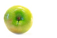 A ripe green delicious apple