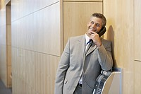 Businessman using pay phone