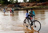 People walking in shallow river water ; Garwa and Latehar ; Jharkhand ; India