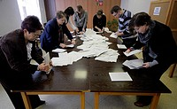 Members of election committee count ballots at the end of second_round presidential poll in Nove Veseli, hometown of Milos Zeman , on Saturday, Jan 26...