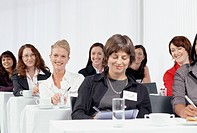 Businesswomen Enjoying Seminar