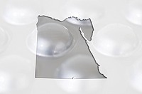 Outline map of egypt with pills in the background for health and