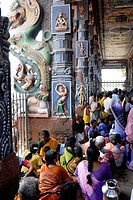 Devotees sitting in front of pillared hall in Subrahmanya Swami temple , Tirupparankundram , Tamil Nadu , India