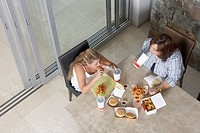 Daughter and Mother Eating Fast Food