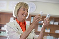 Woman Comparing Medications