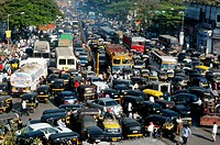 Traffic at the congested saki naka junction on the andheri ghatkopar road , Bombay now Mumbai , Maharashtra , India
