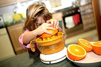 Girl preparing orange juice