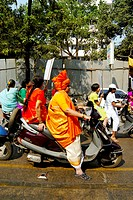 Procession of women wearing traditional dress riding on two wheelers for celebrating Gudi Padva festival , new year of Hindu religion , Thane , Mahara...