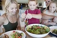 Boy Serving Salad