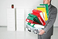Businessman Holding File Folders