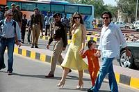 Hollywood model and actress Elizabeth Hurley with husband Arun Nayar and sun crossing road ; Rajasthan ; India NO MR