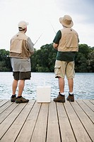 Friends Fishing Off Dock