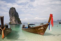 Boat in the green clean sea water , Krabi Island , Thailand