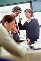 Businesswoman complaining in a meeting