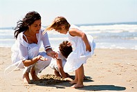 Mother with two children on the beach