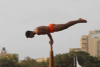 Malkhamb performance ; the ancient form of Indian Gymnastics during the annual Mumbai Police Tattoo show at Shivaji Park in Bombay now Mumbai ; Mahara...
