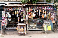 Typical shops of pilgrimage and tourist centre of India selling low cost gift articles , plastic toys at Rameswaram , Char Dham , Tamil Nadu , India