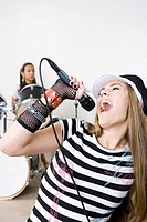 Teen girl singing in band