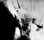 Mahatma Gandhi delivering a speech , 1946 , Satish Das Gupta , his translator , taking notes , India NO MR