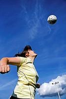 Woman soccer or football player header