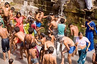 Devotees having holy water bath in the well , Lonar , Buldhana , Vidharbha , Maharashtra , India