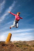 Girl jumping in the blue sky